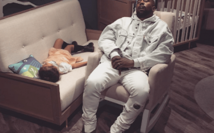 Kim Shares An Adorable Photo of Kanye And North West Passed Out In A Store While Shopping
