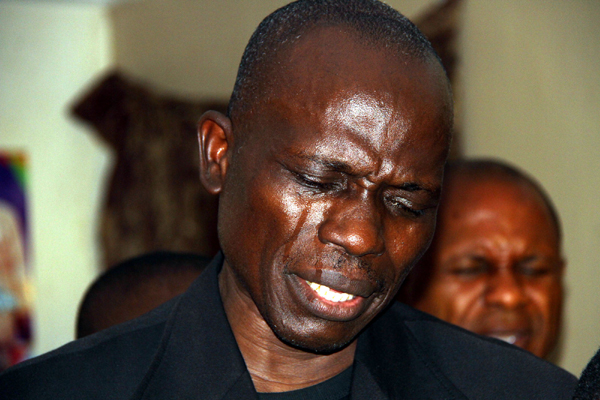 Pastor Elisha, whose wife was murdered in Abuja crying yesterday.