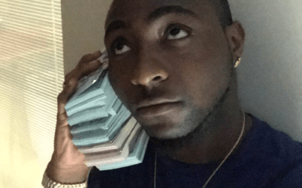 Davido Shows Off Bundles of $100 Dollar Bills